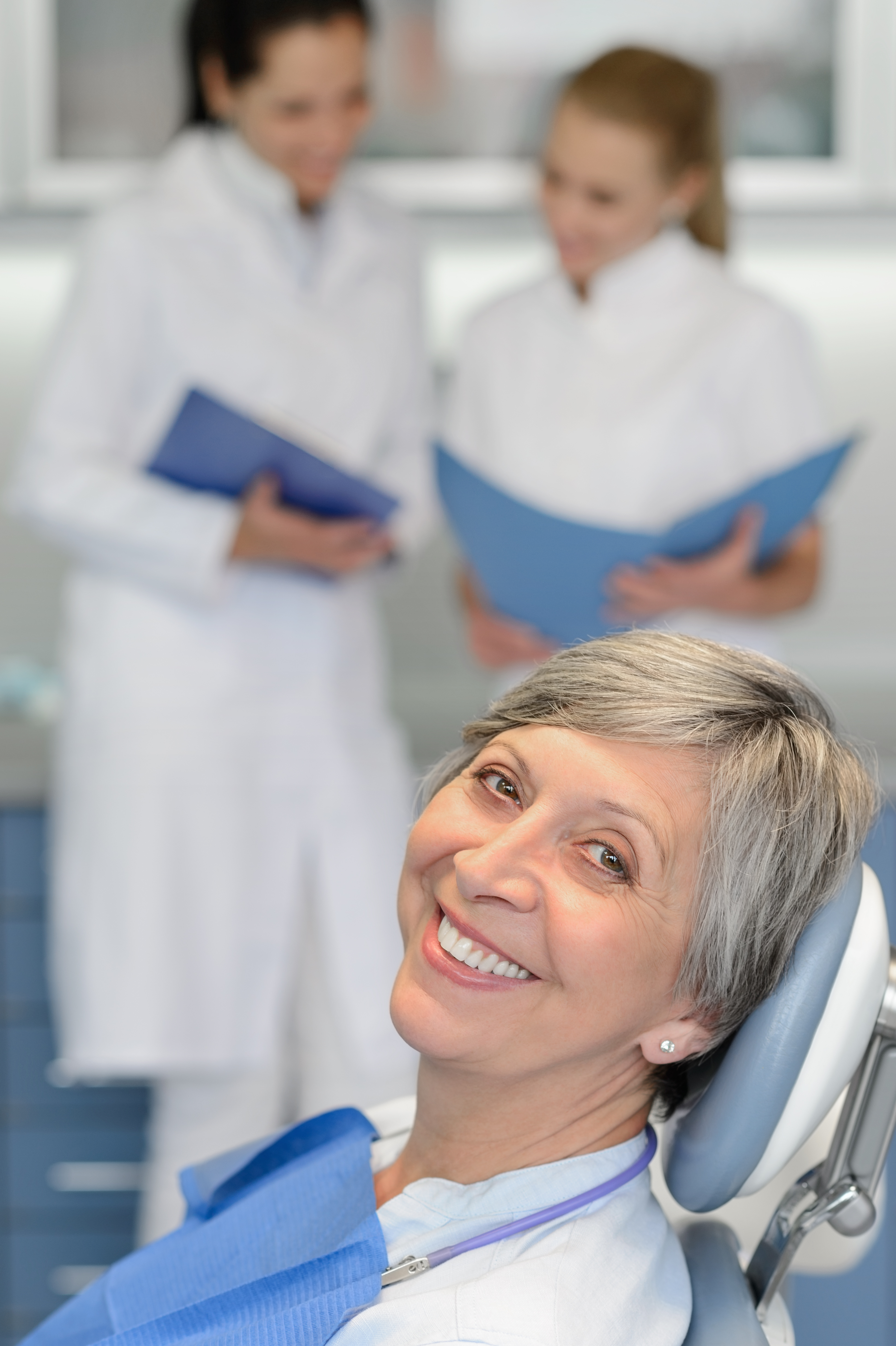 Mature Woman Sitting in Dental Chair Smiling