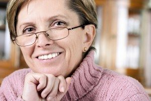 Mature Female in Pink Turtle Neck Sweater and Glasses