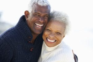 African American Couple Smiling and Embracing