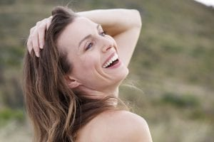 Mature Woman Flipping Head Back Smiling